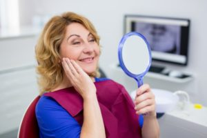 older woman happy with dental implants in Chelsea